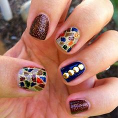 Glittered stained glass nail art with metal sequins    See more at http://www.nailsss.com/colorful-nail-designs/2/