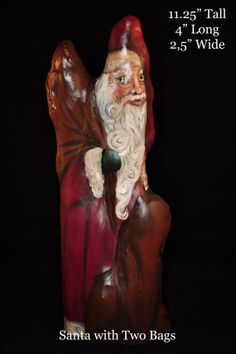 Louisiana artist crafts one of a kind Santa Claus collectibles from dried cypress knees.