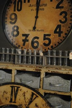 Love this huge clock with test tubes repurposed as bud vases
