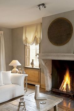 light living room with fireplace, roman shades in belgium