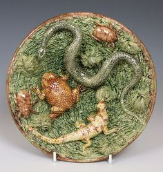 A Portuguese Palissy ware plate with a good selection of reptilia and insects. Portugal c1880  Dimensions in Inches: Dia: 9.25 ins