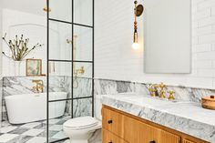 Master bath clad with marble and white tiles in SoHo, Manhattan, New York City [3000×2000] - Imgur