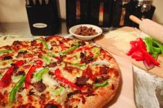 From unique cheese blends to sautéed veggies, the deliciousness of a Philly Cheesesteak pizza is in the details. #pizza #recipe #phillycheesesteak