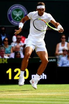 Rafael Nadal of Spain plays a backhand against Jiri Vesely of the Czech Republic during their Men's Singles fourth round match on day seven of the Wimbledon Lawn Tennis Championships at All England Lawn Tennis and Croquet Club on July 9, 2018 in London, England.
