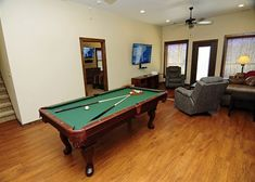 Bear Watch -- Grab the family and head downstairs to play a round of pool or watch TV in the sitting area Queen Bedroom Suite, Gatlinburg Cabin Rentals, Flat Panel Tv, Romantic Honeymoon, Luxury Decor, Large Bedroom, Gas Fireplace, Sitting Area, Bear