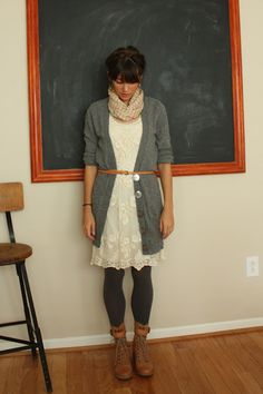 White lace dress with long gray cardi, striped scarf and combat boots.