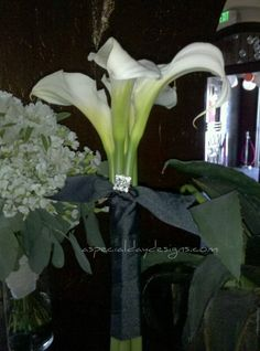 "white arctic callas.  They are are larger than the ""posey"" or mini type, and lend themselves well for a bouquet.  Love the very art deco look of them!"
