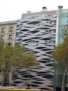 """I really like the flowing quality to these """"ribbons"""" on the building in #Barcelona"""