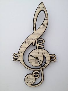 Treble Clef Vintage Music Clock by Neltempo: Genuine vintage music mounted onto birch plywood & cut using laser technology.