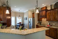 Featuring custom cabinetry, granite counter tops with attractive tile back splash, stainless appliances and a spacious pantry, the gourmet kitchen is both stylish and functional.