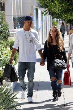 Still going strong: British heiress Chloe Green, 26, was spotted with her new love Jeremy Meeks in West Hollywood on Thursday where they engaged in some PDA while running errands