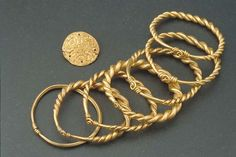 Viking age gold arm rings, found in Sweden.