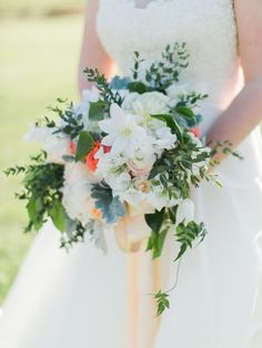 Beautiful Bridal Bouquet Arranged With: White Clematis, White Sweet Peas, Blush Ranunculus, Super Bright Orange Roses, Several Varieties Of Greenery/Foliage Spring Wedding Bouquets, Spring Wedding Flowers, Floral Wedding, Wedding Day, Spring Weddings, Bridal Bouquets, Wedding Table, Bridal Dresses, Wedding Ceremony
