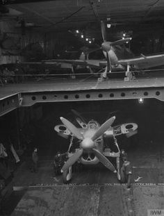 Seafires and Barracuda in the hangar of HMS Furious 1944