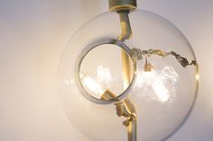 'Lean' Light Brass in different finishes, hand blown glass, gold leaf, LED lighting, dimmable option