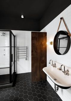 8 Examples Of Tile Flooring With Geometric Patterns // This bathroom uses…