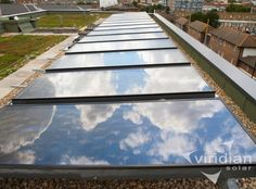Solar panels on flat roof at low angle