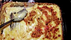 What I made tonight!! Seasoned garlic chicken cut into chunks and baked in a homemade stalk mixed cream of chicken soup mozz cheese fancy blend cheese and topped off with stuffing for a crispy crust!! Mm [2560x1440]