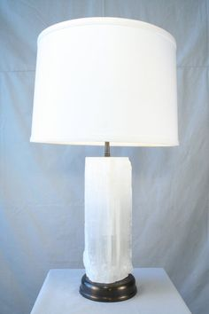 Modern Selenite table lamp made with solid block of selenite no two alike mother natures' wonders. Mounted on brass base with bronze patina double socket assembly. Priced without shade. One only,...