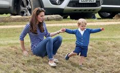 Kate holds George's hand as he takes off down the hill. (Photo: Chris Jackson/Getty Images)