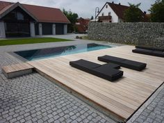 think that entire deck could be on rollers and just roll right over the pool  like