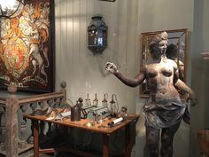A selection of our #wall #lights are laid next to a C18th lead statue of Clytie.