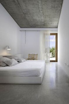 Airy Bedroom with Polished Concrete Floor