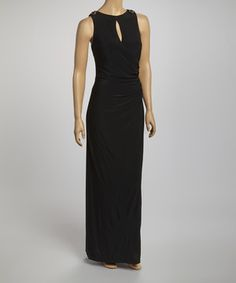 For an elegant evening, choose this draping maxi dress. Its shimmering epaulettes will shine all through the night, complementing the constellations.