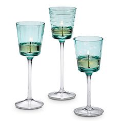 """Our cut-glass holders instantly freshen a room with a wash of mesmerizing turquoise. Can also be used as tealight holders. Set includes one of each height: 6 1/2""""h, 7 1/2""""h and 8 1/2""""h.  Price:   $25.00/set of 3"""