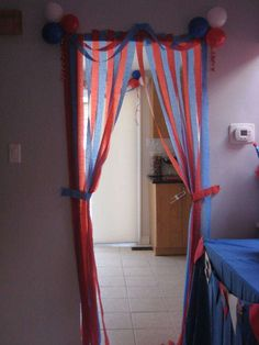 Great (and cheap) way to decorate doorways for a carnival birthday party