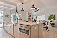 Mind Blowing Kitchen Countertop With Light Fixers & Chandelier