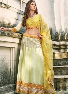 This  Beige Georgette Embroidered Patch Border Work Resham Work Designer Lehenga Choli which will make you look striking and even more beautiful. Made of  Georgetten more beautiful. Made of georgette, It,s quite comfortable to wear and easy to drape as well.