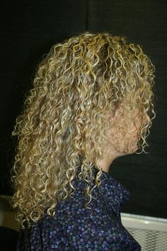 tighter spiral curl in long layered hair