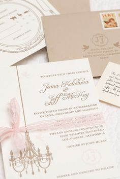 sophisticated chandelier design wedding invitation Photo via Project Wedding