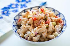 Quick and easy macaroni salad with hard boiled egg, roasted red bell pepper, onion, mayonnaise, and paprika.