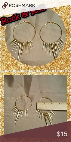 Large Gold Spike hoop earrings Look like a rockstar with the spike earrings. The 2-inch hoops have long gold metal spikes. These are lightweight and comfortable. And so cute! Also available and silver and gunmetal. Jewelry Earrings
