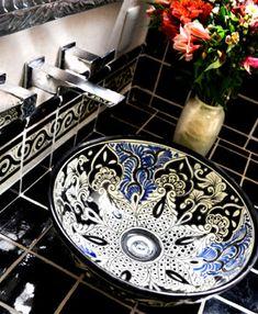 a gorgeous Talavera sink was the inspiration for this elegant Hacienda bathroom..  a marvelous mix of black, white, and blue. Orquidea Negra.