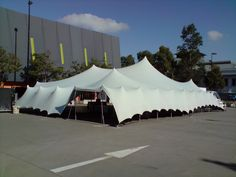 Stretch tents - bolted into concrete hard surface - www.stretchstructures.com