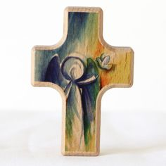 """2.25"""" tall wood. Made in Germany Pocket Prayer Holding Cross This small wooden holding cross is an ideal gift for any occasion, featuring a colorful and graceful modern representation of an angel. Whe"""