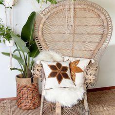 Peacock chair, plants, weave basket. texture love!