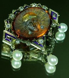Citrine 'Egyptian Queen' cameo brooch, Italian, 1860s. Citrine, old European- and rose-cut diamonds, guilloché enamel and 18K gold.