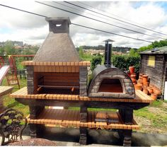 Stone Barbecue with wood fired Pizza Oven