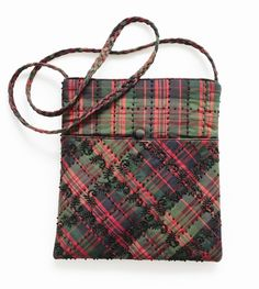 This Satchel is made from pure silk tartan which is then embroidered with black stitching. It is a large bag with a long strap making it very practical. This can be worn by day into night making you stand out from the crowd in this unique style.