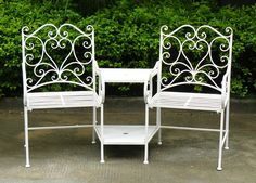 Wrought iron companion seat with heart patterened back. There is a hole in the table to enable you to add a parasol if required, not included. This set is white wash finished with anti rust paint and has two handy shelves for placing drinks or books. Metal Patio Furniture, Garden Furniture Sets, Garden Table And Chairs, Table And Chair Sets, Royal Craft, Wooden Arbor, Iron Bench, Shabby, Outdoor Chairs