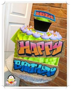 Graffiti Cake - love the graffiti boards on this cake design. They look really effective on the bright green icing.