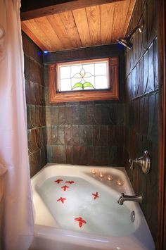 Tiny Texas Homes: Canyon Lake tub & shower... what a great way to have a tub in a tiny house -and I love the old lead shingles as wall waterproofing.