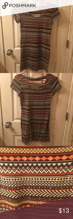 tribal print bodycon dress Tribal print dress. It is stretchy. In great condition-like new! Great to wear to a party Dresses