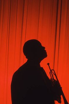 Silhouette of American jazz musician Louis Armstrong as he holds his trumpet Atlantic City New Jersey 1965 Jazz Artists, Jazz Musicians, Amadeus Mozart, Red Images, Louis Armstrong, Harlem Renaissance, Music Aesthetic, Jazz Blues, Music Is Life