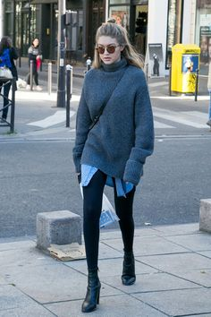 If an oversize sweater is still too short, cover up your derriere, like Gigi Hadid, with an extra-long chambray shirt or a denim shirt dress.