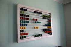 In the past we've taken a look at what to do with an abacus in your home and how to make a rustic version for your tiny tots to play with. Although it's been around for awhile now, that CB2 abacus still has many of us swooning, but like many others, this mom is still refusing to pay full retail price and set out to make her own.